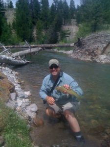 Fly fisherman holding a nice cutthroat trout from an Idaho stream - This is a sneaky thing that has bitten me in the rear before. Not everyone is an expert fly fisherman. We all learn from watching and asking those that we choose to fish with. There are certain knowledge points however, that should be known by everyone who claims to know how to strip line (another term to test for) from a fly reel.